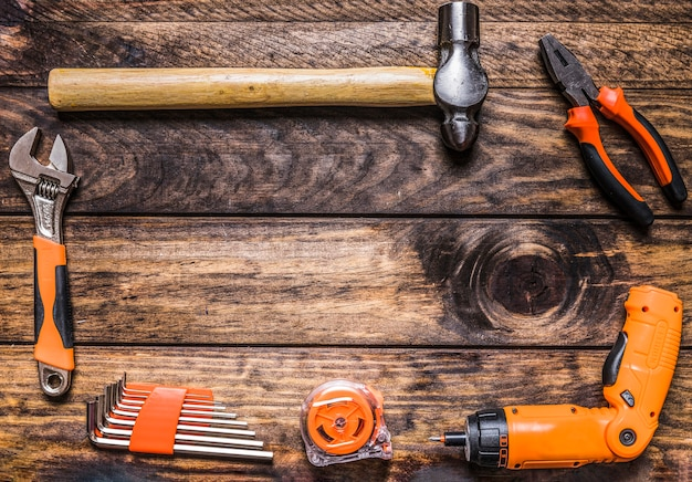 Different types of worktools on wooden background Free Photo