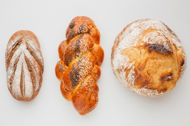 Different varieties of bread and pastry Free Photo