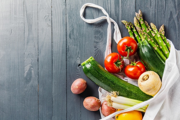 Different vegetables in textile bag on grey copyspace Free Photo