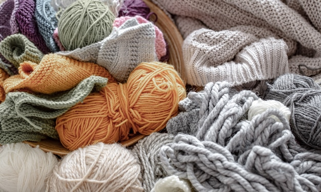 Different yarn for knitting in pastel and bright colors. Premium Photo