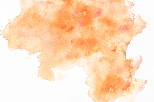 Diffuse orange watercolor splash Free Photo