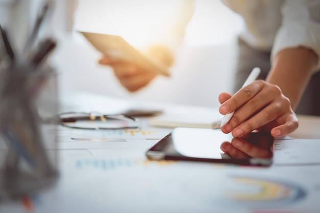 Digital marketing, businessman using digital tablet and documents on office desk background. Premium Photo