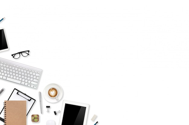 Digital marketing office table with laptop computer, office supplies, and cell phone on white Premium Photo