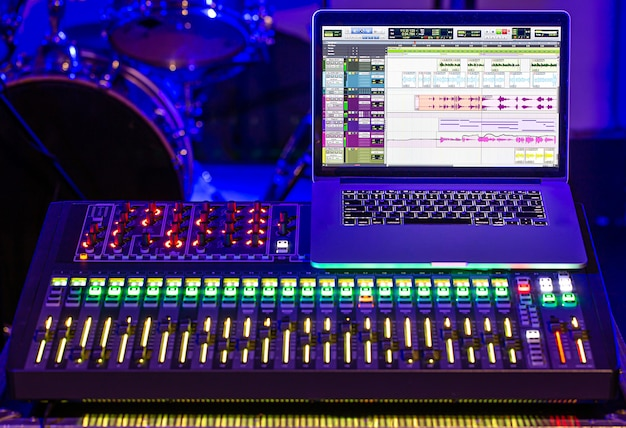 Digital mixer in a recording studio, with a computer for recording sounds and music. concept of creativity and show business. Free Photo
