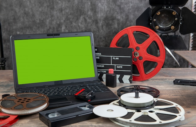 Digitizing old 16 mm film with laptop and green screen Premium Photo