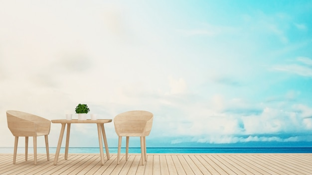 Dining area on terrace sea view - 3d rendering Premium Photo
