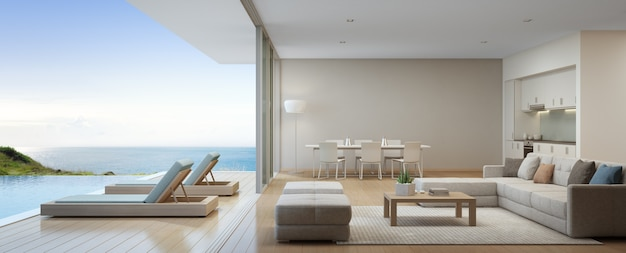 Dining and living room of luxury beach house Premium Photo