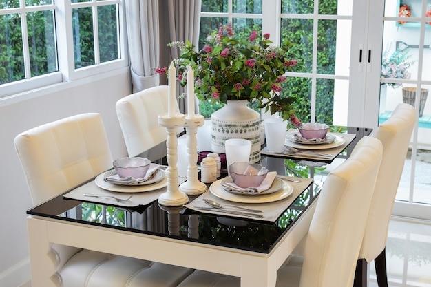 Dining table and comfortable chairs in vintage style with elegan Premium Photo