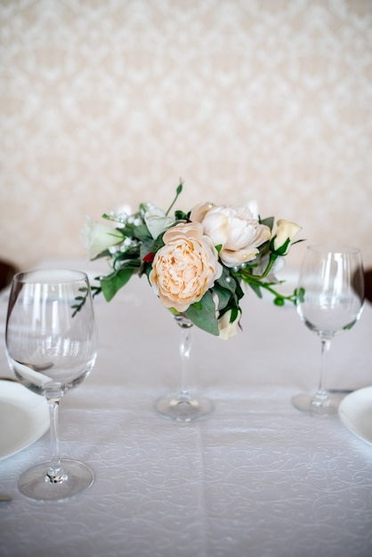 Dining table setting decorated with flowers. Premium Photo