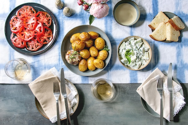 Dinner table with baked potatoes Premium Photo