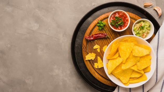 Dipping nacho chips Free Photo