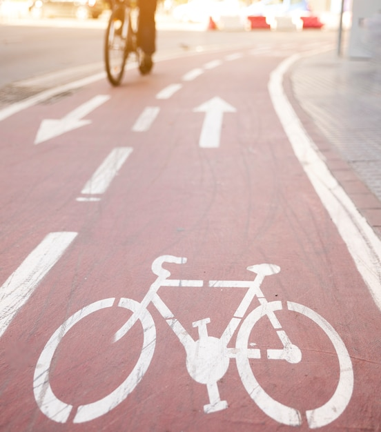 Directional arrows and bicycle sign on cycle lane Free Photo