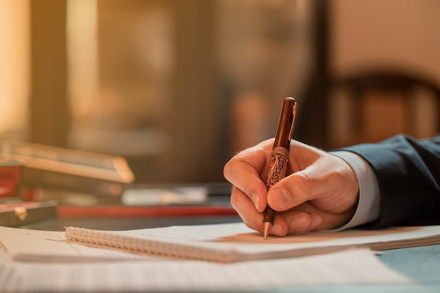 Director signing documents with a fashion pen. high quality photo Free Photo