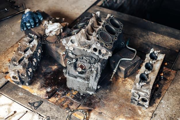 Dirty auto engine in garage Premium Photo