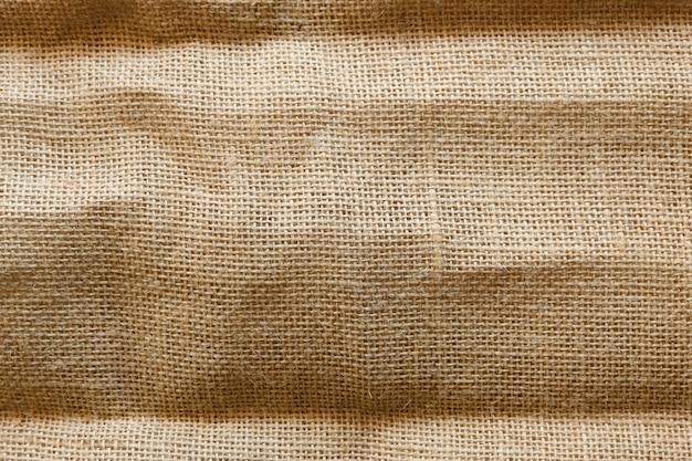 Dirty burlap texture background, brown cotton fabric texture, canvas Premium Photo