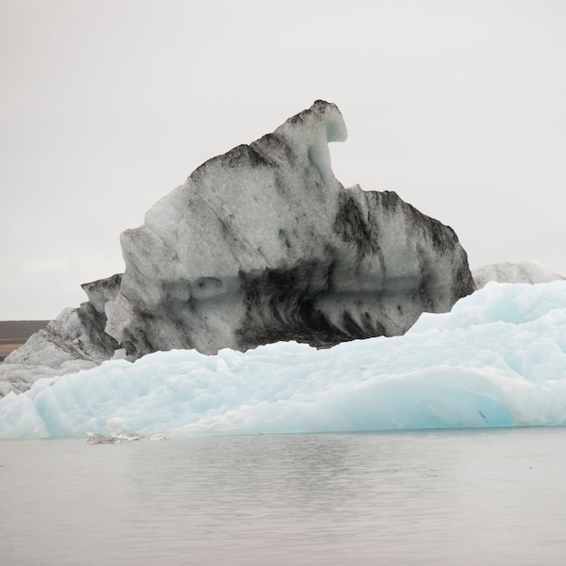 Dirty and clean icebergs floating in glacial lake Premium Photo