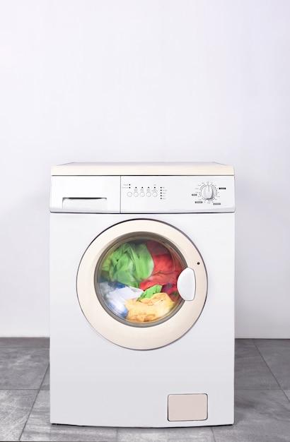 Dirty clothes washed on washing machine Premium Photo