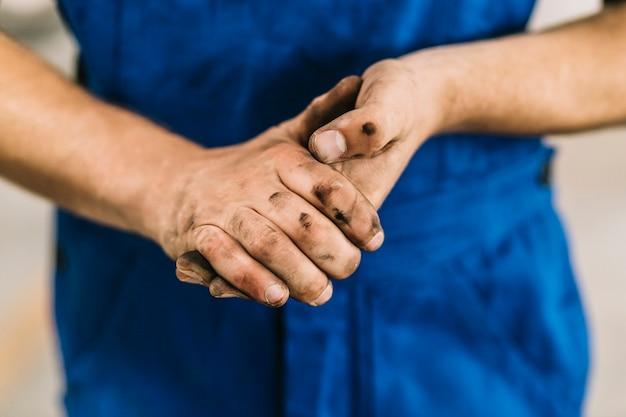 Dirty hands of mechanic Free Photo