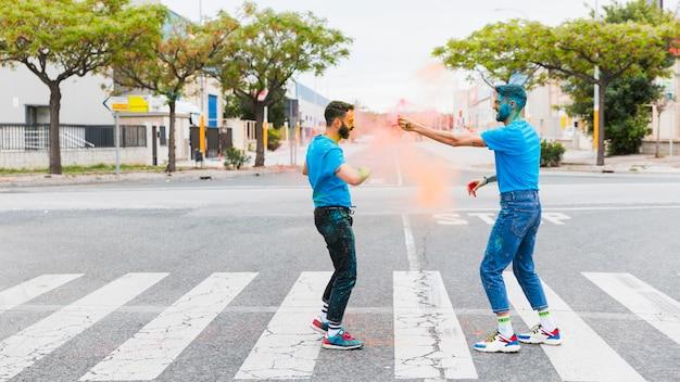 Dirty joyful gay couple having fun on road Free Photo