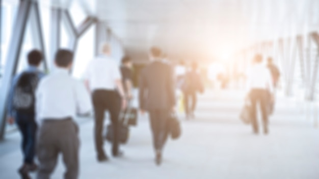Dis focus of business people walking in the corridor at business center Premium Photo