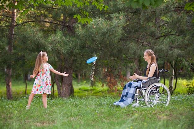 Disabled girl plays badminton. Premium Photo