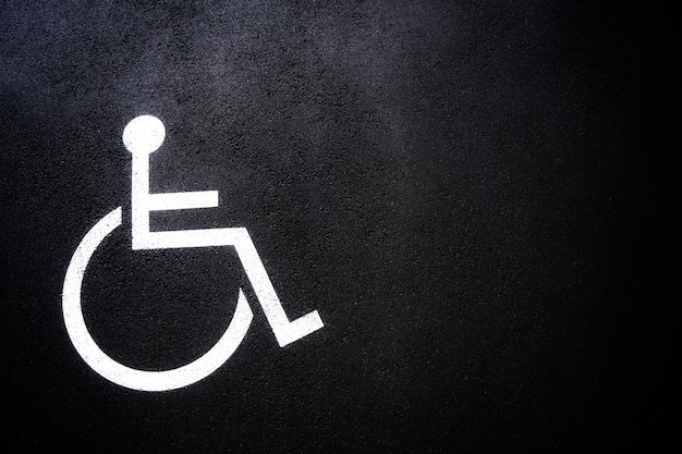 Disabled people icon or handicap symbol on parking space. Premium Photo