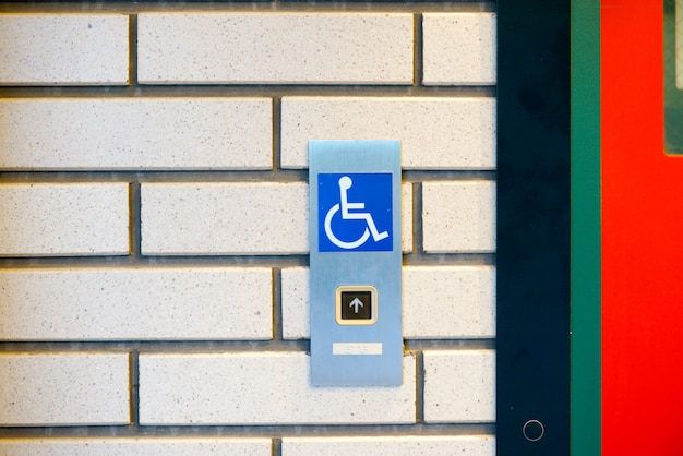 Disabled sign in the lift Premium Photo