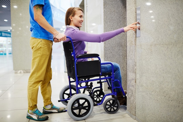 Disabled woman using elevator Free Photo