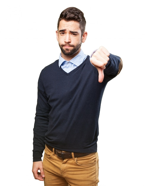Disappointed man with thumb down Free Photo