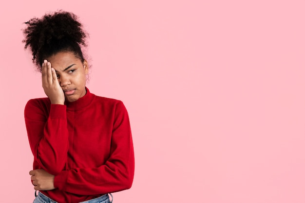 Disappointed woman posing with copy space Premium Photo