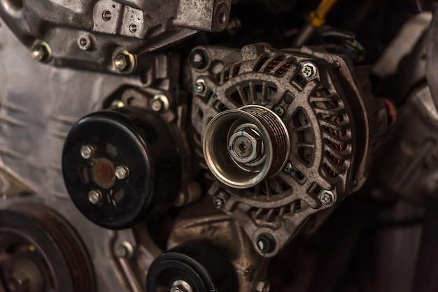 Disassembled car dirty engine and dynamo at garage Premium Photo