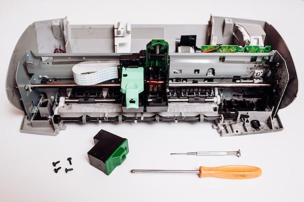 Disassembled ink jet printer on white Premium Photo