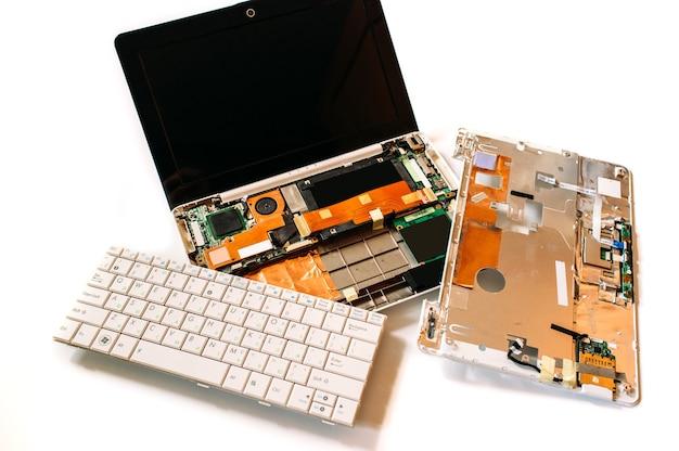 Disassembled laptop on white surface Premium Photo
