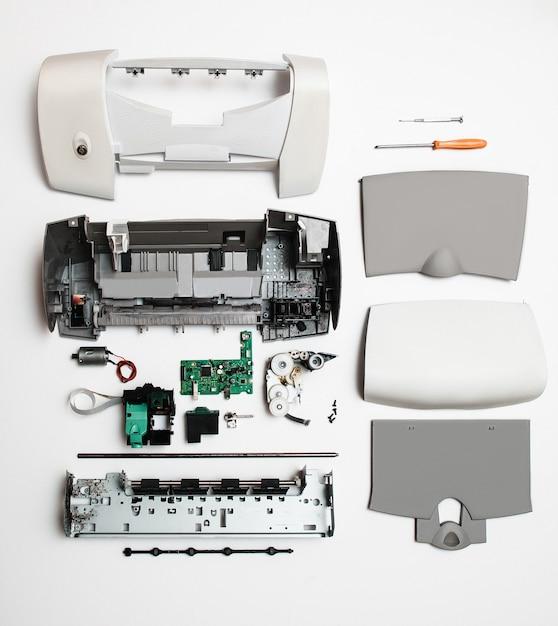 Disassembled printer parts on white Premium Photo