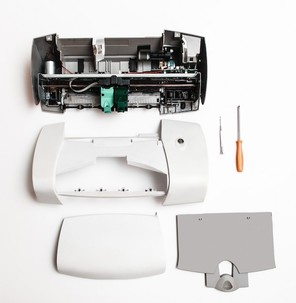 Disassembled printer on a white surface Premium Photo