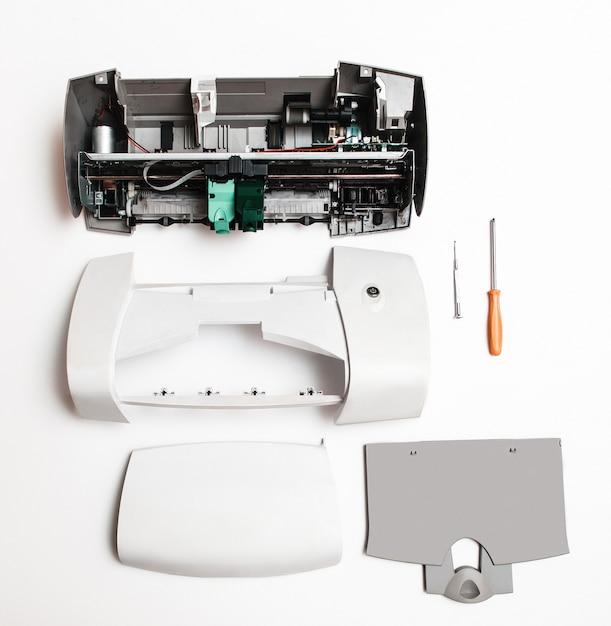 Disassembled printer on white Premium Photo