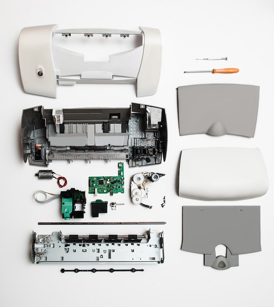 Disassembled printer on white Premium Photo