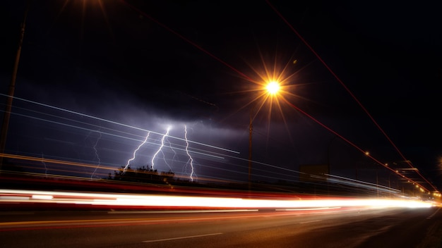 Discharges of lightning in the night sky over the road background Premium Photo