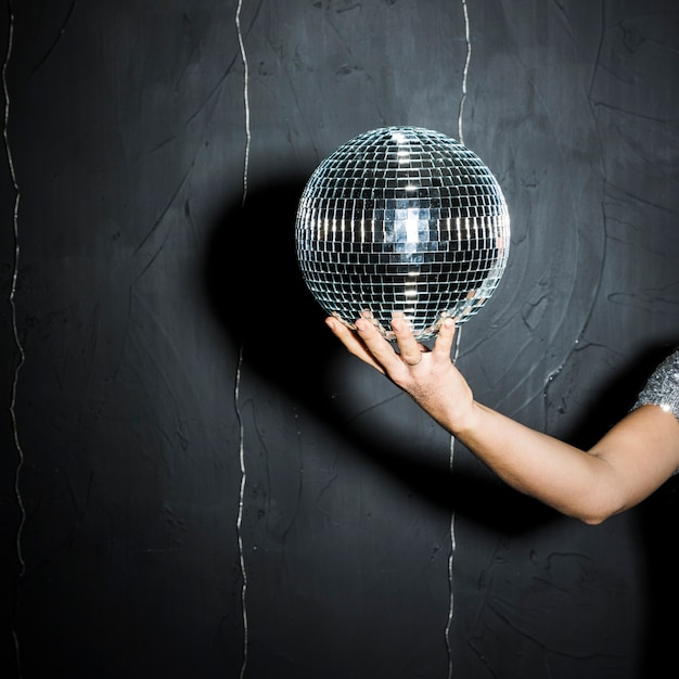 Disco ball on woman's hand Free Photo