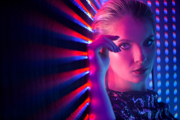Disco dancer in neon light in night club. fashion model woman in neon light Premium Photo