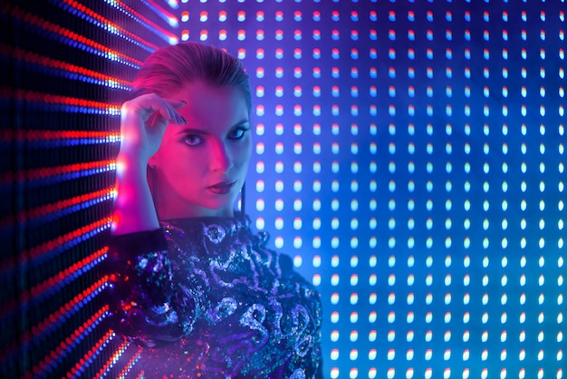 Disco dancer in neon light in night club. fashion model woman in neon light Premium Photo
