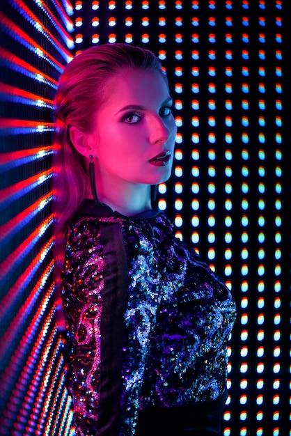 Disco dancer in neon light in night club. Premium Photo