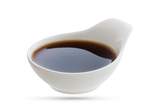 Dish of soy sauce isolated on white Premium Photo