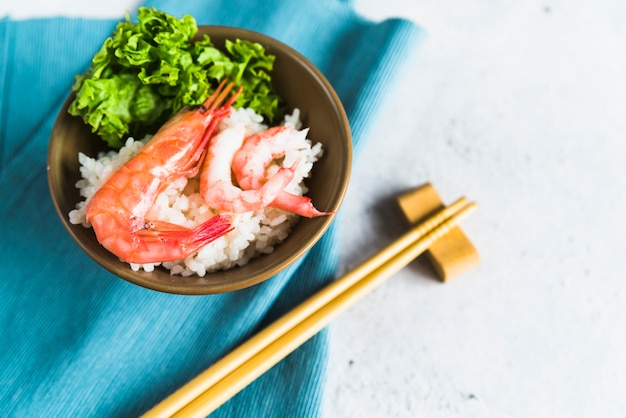 Dish with shrimps, rice and parsley Free Photo