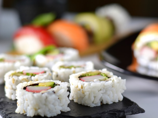 Dish with various types of sushi, some of bluefin tuna and other salmon Premium Photo