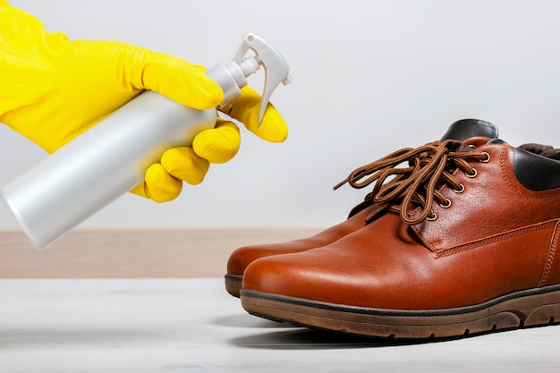 Disinfection to clean shoes from coronavirus and bacteria. Premium Photo
