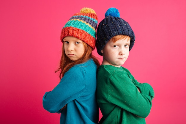 Displeased angry little children Free Photo