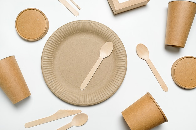 Premium Photo | Disposable tableware made of bamboo wood and paper.