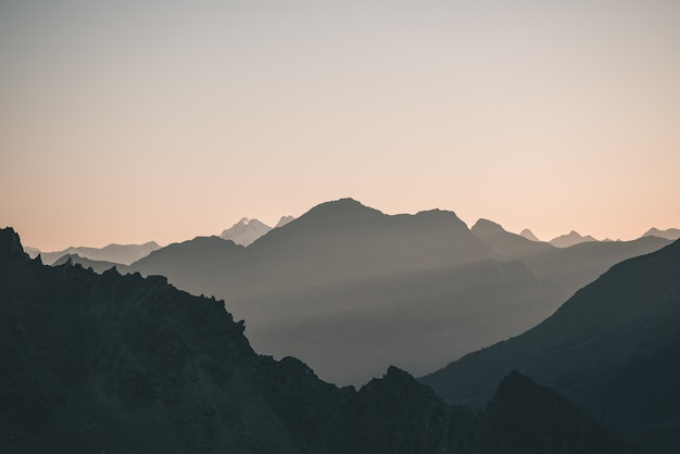 Distant mountain silhouette with clear sky and soft light Premium Photo