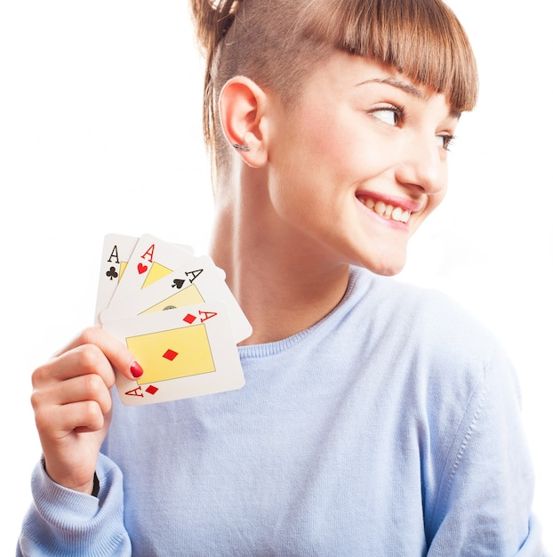 Distracted girl showing her cards Free Photo